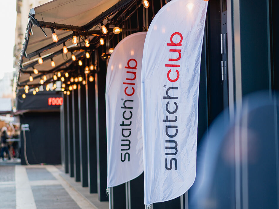 Swatch Club flag in front of an event